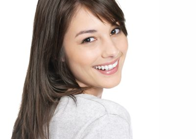 Pretty young female smiling at you - White background
